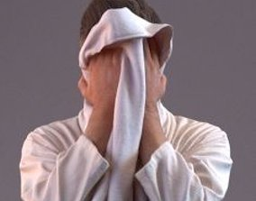 3D Man in bathrobe drying his face