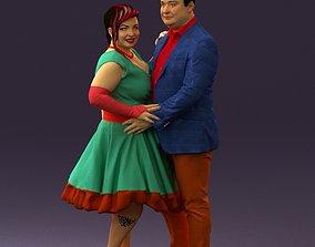 3D printable model Man in suit hugs woman in green 0628