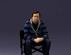 miniature 3D model Man is sitting on a chair 0182
