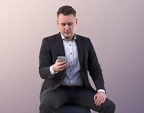 Henry 10941 - Sitting Guy in Suit 3D model game-ready