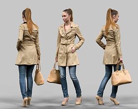 Girl walking in Raincoat 3D asset