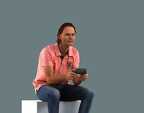 Low poly set of 3D men sitting in various poses