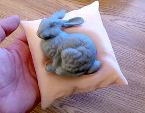 3D printable model Stanford bunny resting on a pillow