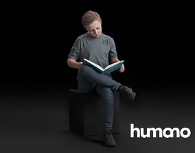 Humano Boy sitting and reading a book 0511 3D